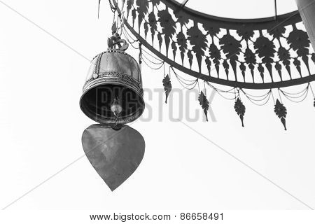 Bell Hanging From Traditional Metal Umbrella, Black And White
