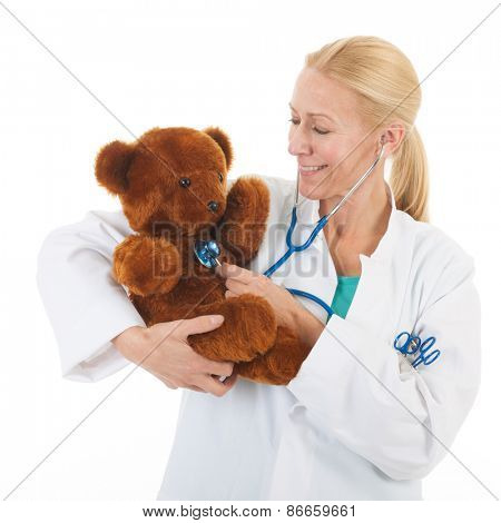 pediatrician listening to heartbeat from stuffed bear