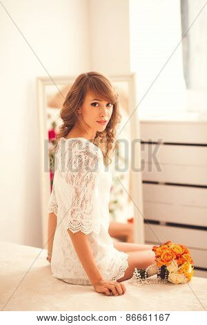 Sensual Portrait Of A Young Woman In The Bedroom