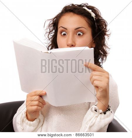 Close up portrait of a brunette teenage girl reading a book, isolated on white background