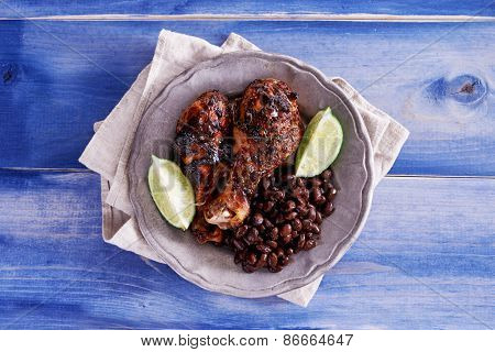 grilled jamaican jerk chicken with black beans shot top down