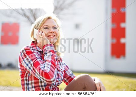 Woman In Flannel Shirt Calling Outdoor