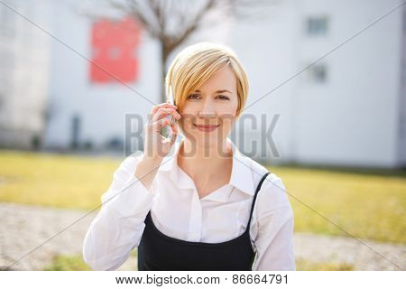 Blonde Woman In Formal Wear Calling Outdoor