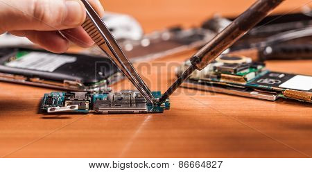 Employee Repairing Fractured Phone