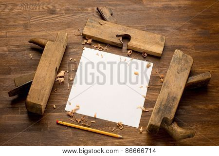 Old wooden jointers on the wood table with grunge texture and paper