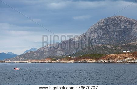 Coastal Norwegian Landscape With Mountains, Sea And Sky