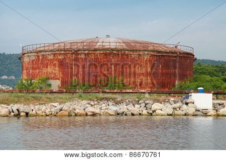 Large Old Rusted Oil Tank On The Lake Coast, Port Of Varna