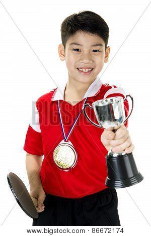 Portrait Of Happy Asian Boy Play Table Tennis