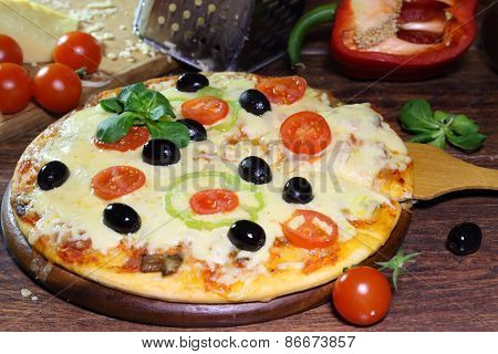 Pizza With Tomatoes, Mushrooms, Olives, Rucola And The Fused Cheese