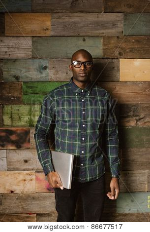 Portrait Of Serious Young African Man With A Laptop