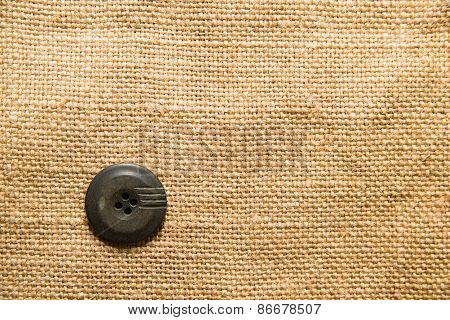 One Big Vintage Button On  Old Cloth