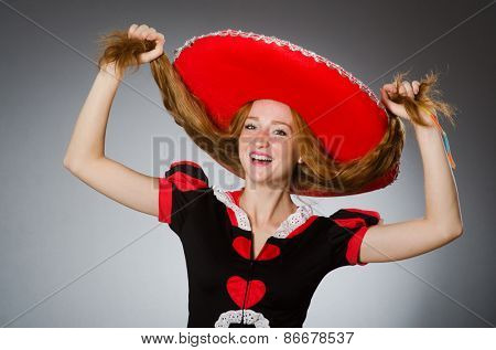 Nice woman wearing red sombrero hat