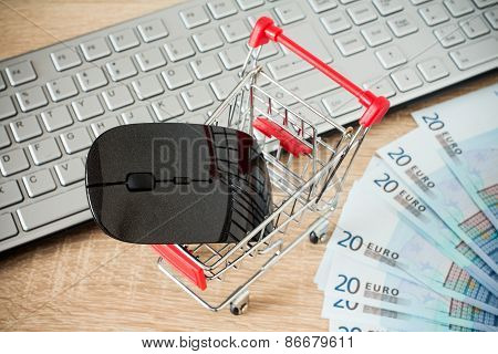Shopping Cart With Mouse In Front Of Computer Keyboard