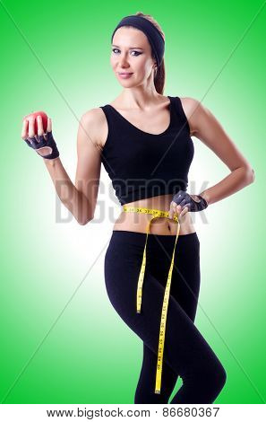 Woman with centimeter in health concept