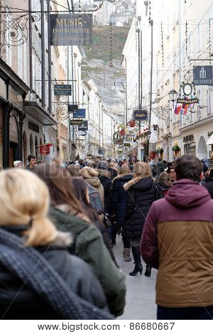 SALZBURG, AUSTRIA - DECEMBER 13, 2014: A lot of people visit the popular street of Salzburg, the Getreidegasse before Christmas. Salzburg, Austria on December 13, 2014.