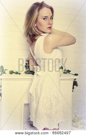 Beautiful Blond Girl With Blue Eyes In A White Dress Looks Strictly