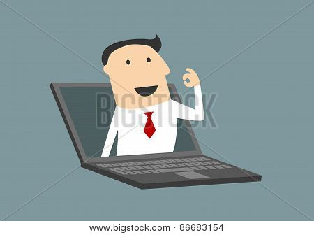 Businessman gesturing ok in laptop screen