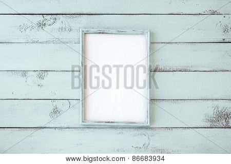 Wooden photo frame on mint shabby chic background