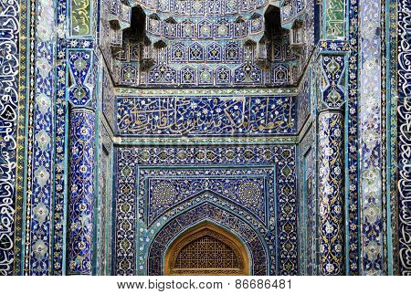 BUKHARA, UZBEKISTAN - MARCH 14, 2015: Facade of an ancient mosque Kalon