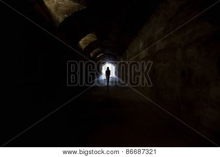 Figure In Dark Tunnel
