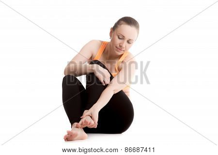 Young Female Athlete Feeling Pain In Foot
