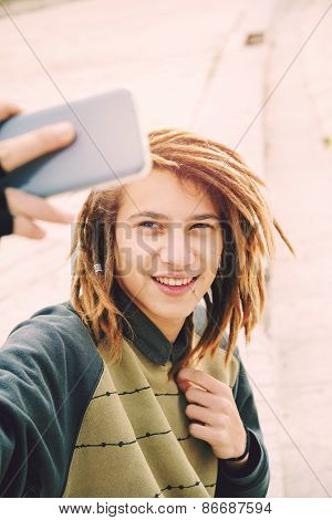 Handsome Rasta Teen Guy Selfie In The City Warm Filter Applied
