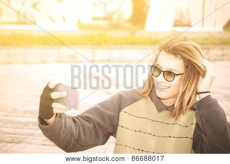 Young Handsome Rasta Teen Guy With Sunglasses Selfie In The City Warm Filter Applied