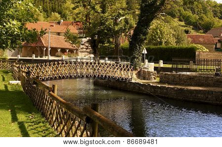 Bridge Over A Canal In The Medieval Town Of Quincerot In Bourgogne, France
