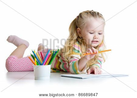 child girl drawing with pencils in nursery