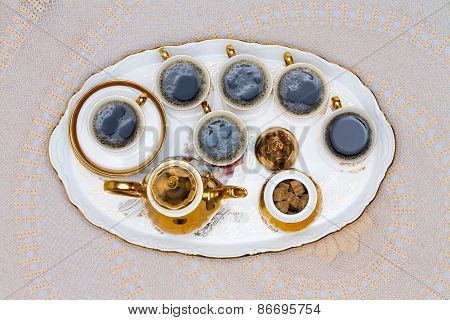 Six Cups Of Turkish Coffee Served On White Table