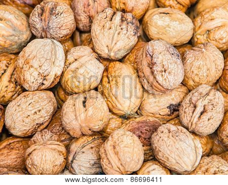 Dried whole walnuts on market in Catania, Sicily, Italy.
