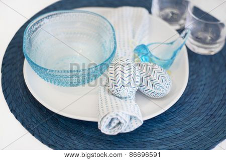 Easter dinner table placement within a blue theme - eggs and chick bowl