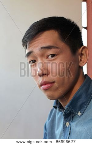 Handsome young Asian man looking at camera