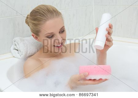 Beautiful Woman Washing In Bath With Sponge And Shower Gel