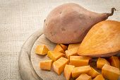 picture of dice  - sweet potato cut and diced on a cutting board - JPG