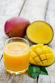 picture of mango  - mango juice and fresh mango on a white wood background - JPG
