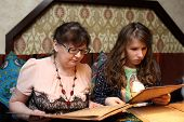 pic of grandma  - Grandma with grandchild looking menu in the restaurant - JPG