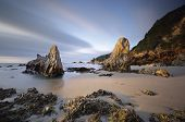 stock photo of rocking  - Early morning light skimming the rock forms at Glasshouse Rocks - JPG