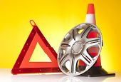 image of rectifier  - traffic cone and car accessories on yellow background - JPG