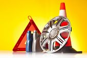 stock photo of rectifier  - car accessories and rad emergency items n yellow background - JPG