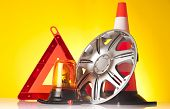 image of rectifier  - warning triangle and car service accessories on yellow background - JPG