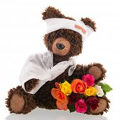 stock photo of get well soon  - Stuffed hand made poorly bear with plaster and flowers for  - JPG