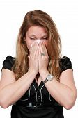 stock photo of blowing nose  - Beautiful woman with a cold hay fever or allergies blowing her nose - JPG