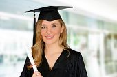 picture of graduation gown  - Graduation of a woman dressed in a black gown - JPG