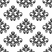 foto of tendril  - Foliate seamless pattern background in black and white colors with elegant curly leaves and tendrils compositions suited for wallpaper or textile design - JPG