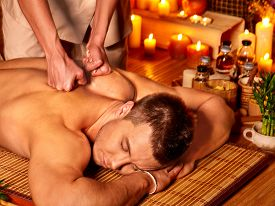 picture of therapist  - Man getting massage in spa - JPG