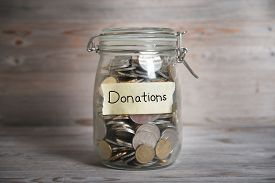 pic of emergency light  - Coins in glass money jar with donations label - JPG