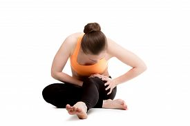 pic of hurt  - Young athlete girl in sportswear massaging sore thigh muscles hurt after sport training feeling pain - JPG