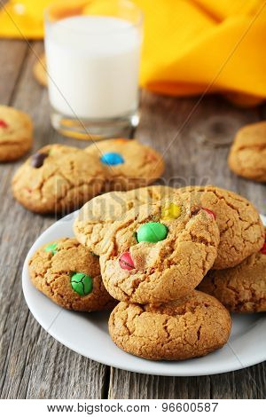 Cookies With Colorful Candy On Plate On Grey Wooden Background