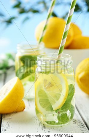 Fresh Lemonade With Lemon On White Wooden Background
